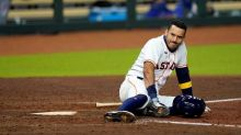 Astros' Correa injured after fouling ball off ankle or foot