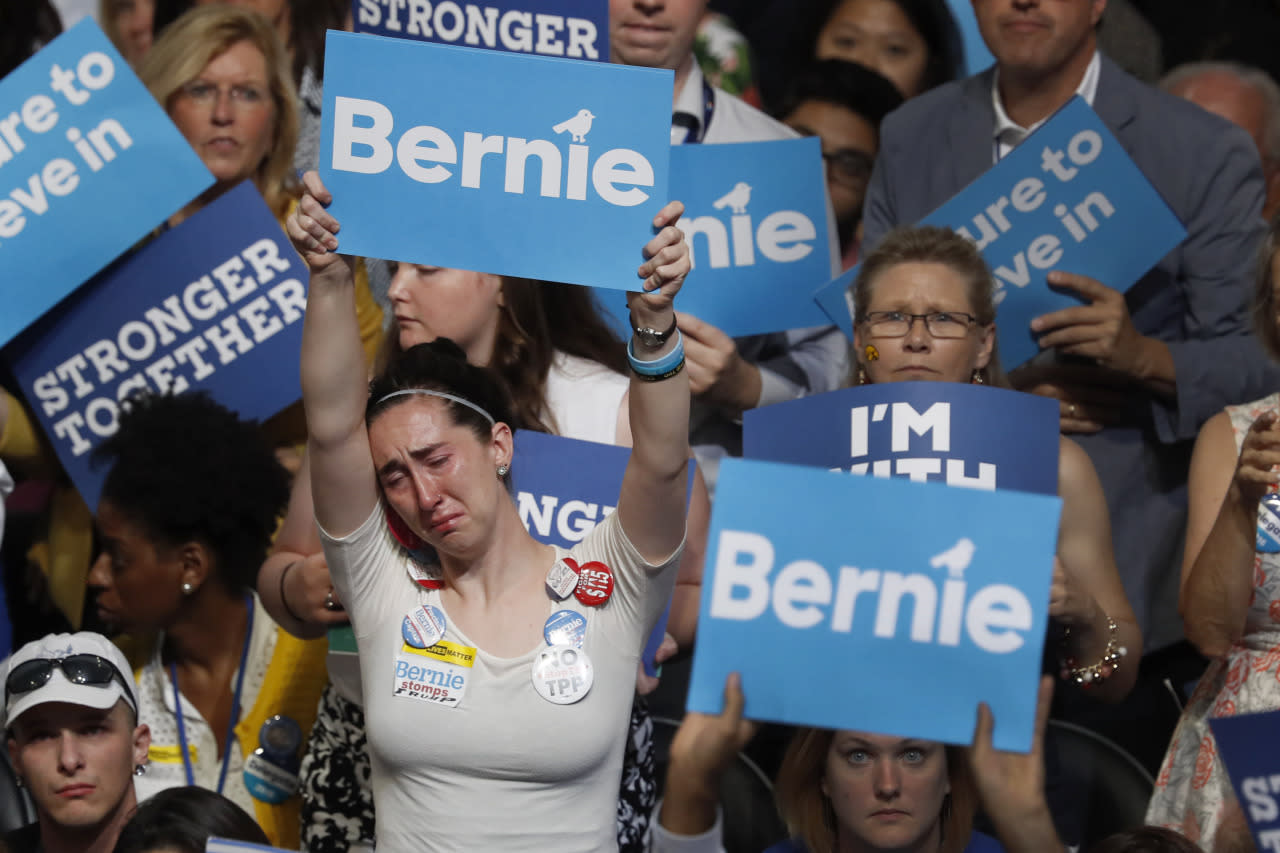 <p>A disappointed supporter for Former Democratic presidential candidate, Sen. Bernie Sanders, I-Vt., holds up her sign during the first day of the Democratic National Convention in Philadelphia, July 25, 2016. (AP Photo/Mary Altaffer)</p>