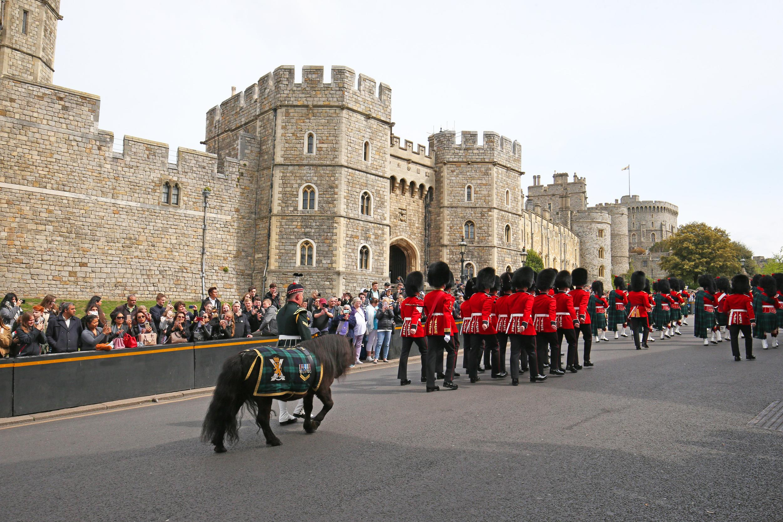 Crowds watch the changing of the guard at Windsor Castle in Berkshire, following the announcement of the birth of a baby boy to the Duke and Duchess of Sussex. (Photo by Jonathan Brady/PA Images via Getty Images)