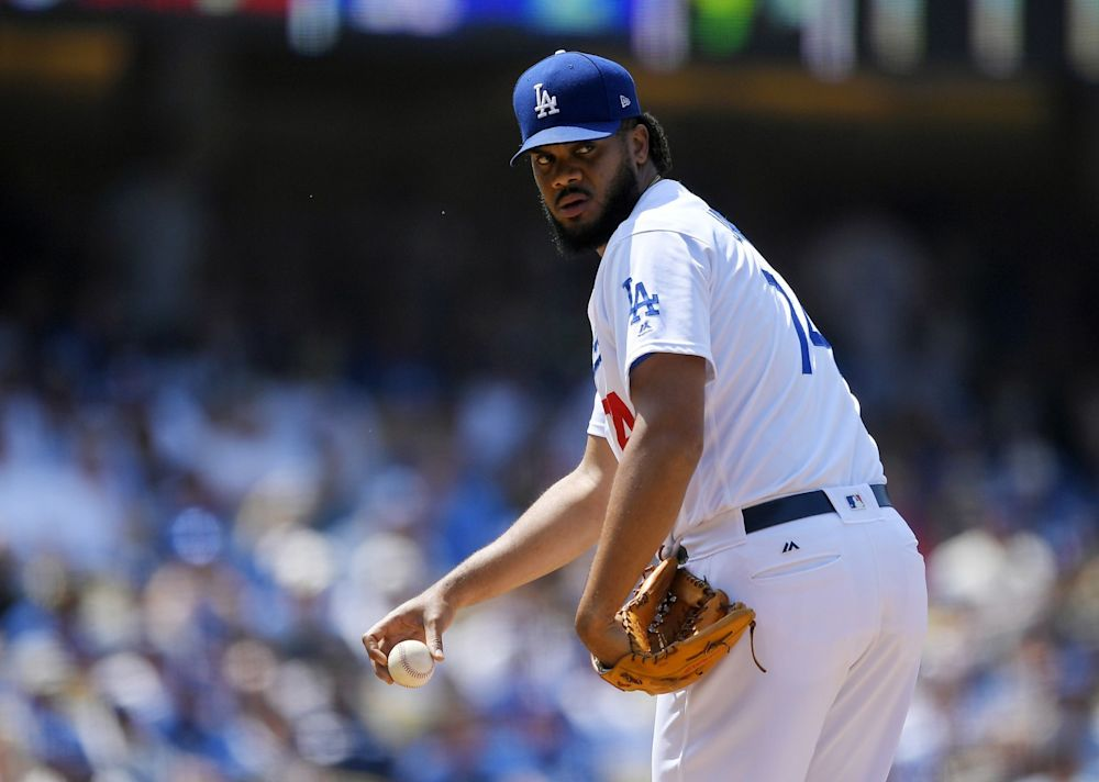 Los Angeles Dodgers relief pitcher Kenley Jansen checks first before throwing to the plate during the ninth inning of a baseball game against the Washington Nationals, Wednesday, June 7, 2017, in Los Angeles.
