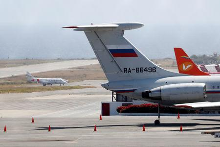 FILE PHOTO: An airplane with the Russian flag is seen at Simon Bolivar International Airport in Caracas, Venezuela March 24, 2019. REUTERS/Carlos Jasso/File Photo