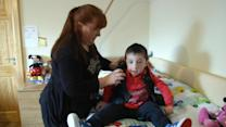 Lightweight 'Upsee' harness allows severely disabled children to walk