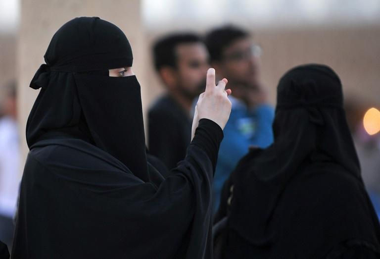 Women in Saudi Arabia are required to wear long black abaya robes and cover their hair in public