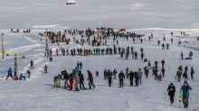 AP Photos: Snow fills Kashmir resort with tourists again