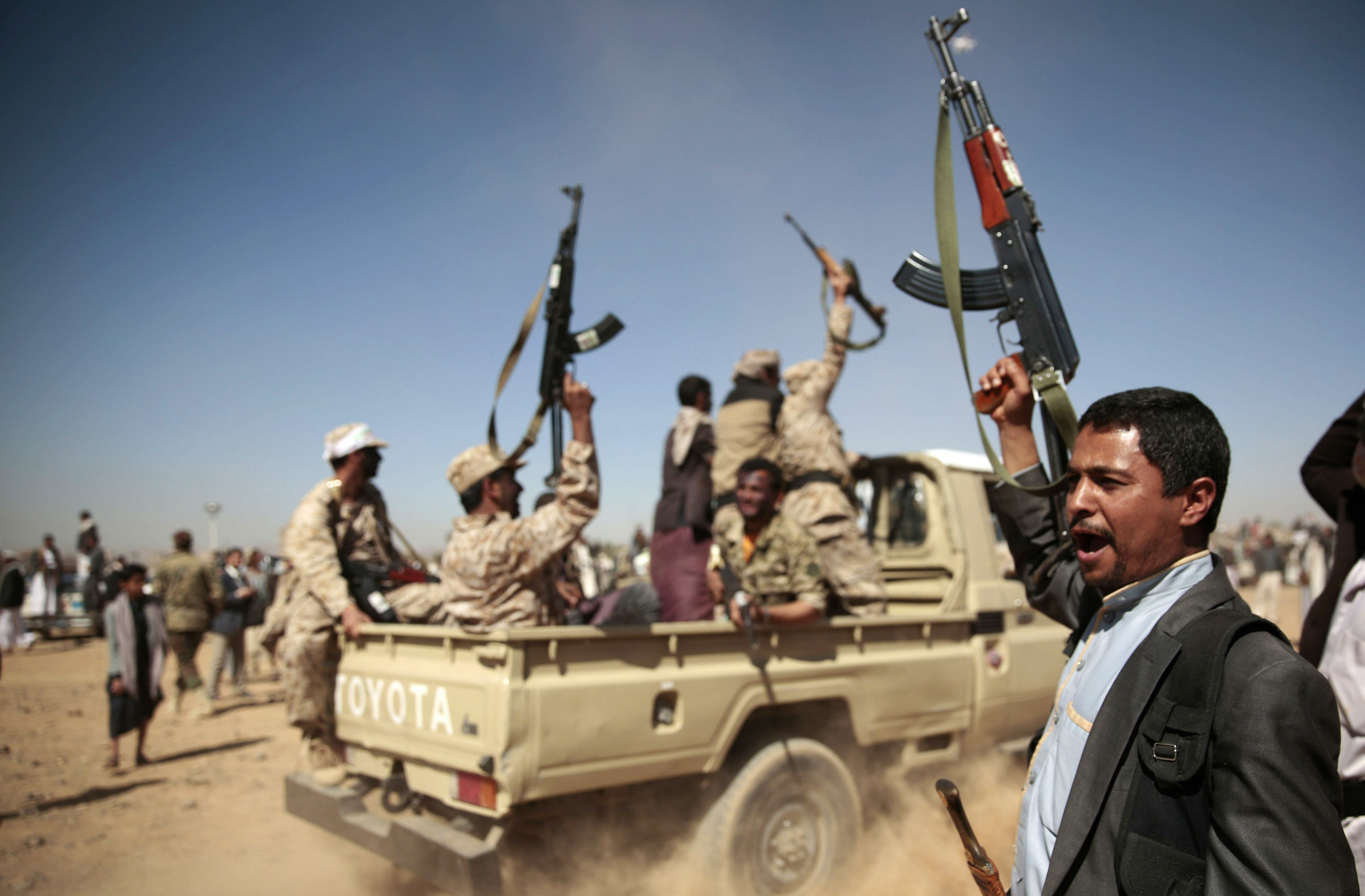 FILE - In this Jan. 3, 2017 file photo, tribesmen loyal to Houthi rebels chant slogans during a gathering aimed at mobilizing more fighters into battlefronts to fight pro-government forces, in Sanaa, Yemen. Moroccan government officials said Thursday Feb. 7, 2019 that Morocco has stopped taking part in military action with the Saudi-led coalition in Yemen's war, and has recalled its ambassador to Saudi Arabia. (AP Photo/Hani Mohammed, File)