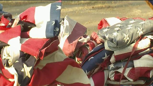 Old American flags retire in flames