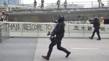 Police rush Hong Kong protesters after being pelted with rocks