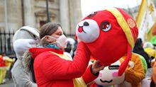 In Pictures: Cautious fans wear masks for London's Chinese new year celebrations