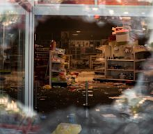 Minneapolis Target descends into chaos as looters smash windows, destroy shelves, and haul away everything inside amid protests against the death of George Floyd