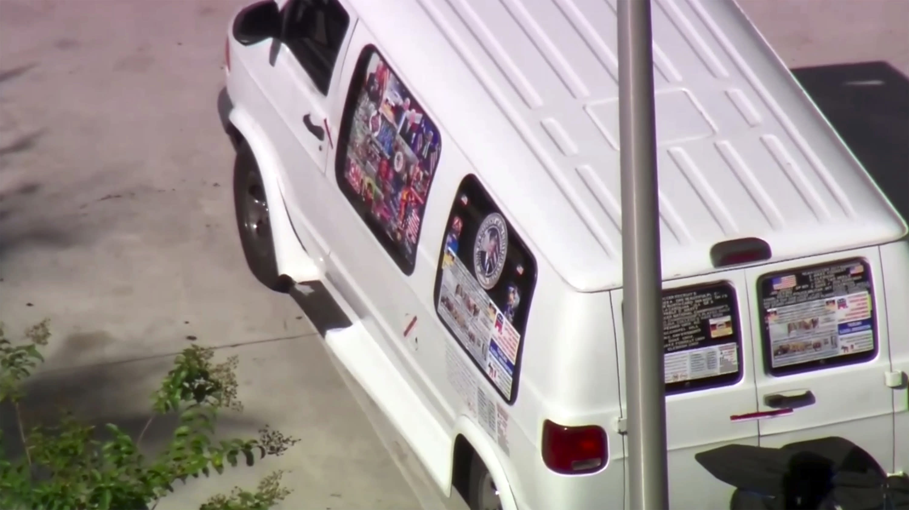 <p>This frame grab from video provided by WPLG-TV shows a van parked in Plantation, Fla., on Friday, Oct. 26, 2018, that federal agents and police officers have been examining in connection with package bombs that were sent to high-profile critics of President Donald Trump. The van has several stickers on the windows, including American flags, decals with logos and text. (Photo: WPLG-TV via AP) </p>