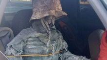 Man dresses up skeleton to drive in car-sharing lane