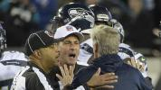 NFL fines Carroll, Payton for entering field of play