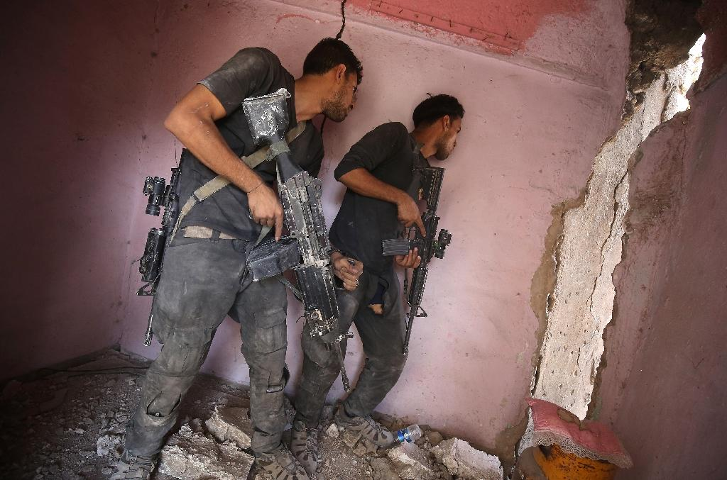 Members of Iraq's elite Counter-Terrorism Service, which spearheaded the operation to retake Mosul, pictured in the city in July 2017