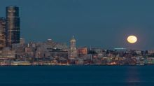Stunning time-lapse footage captures 'super worm moon' rising above Seattle skyline