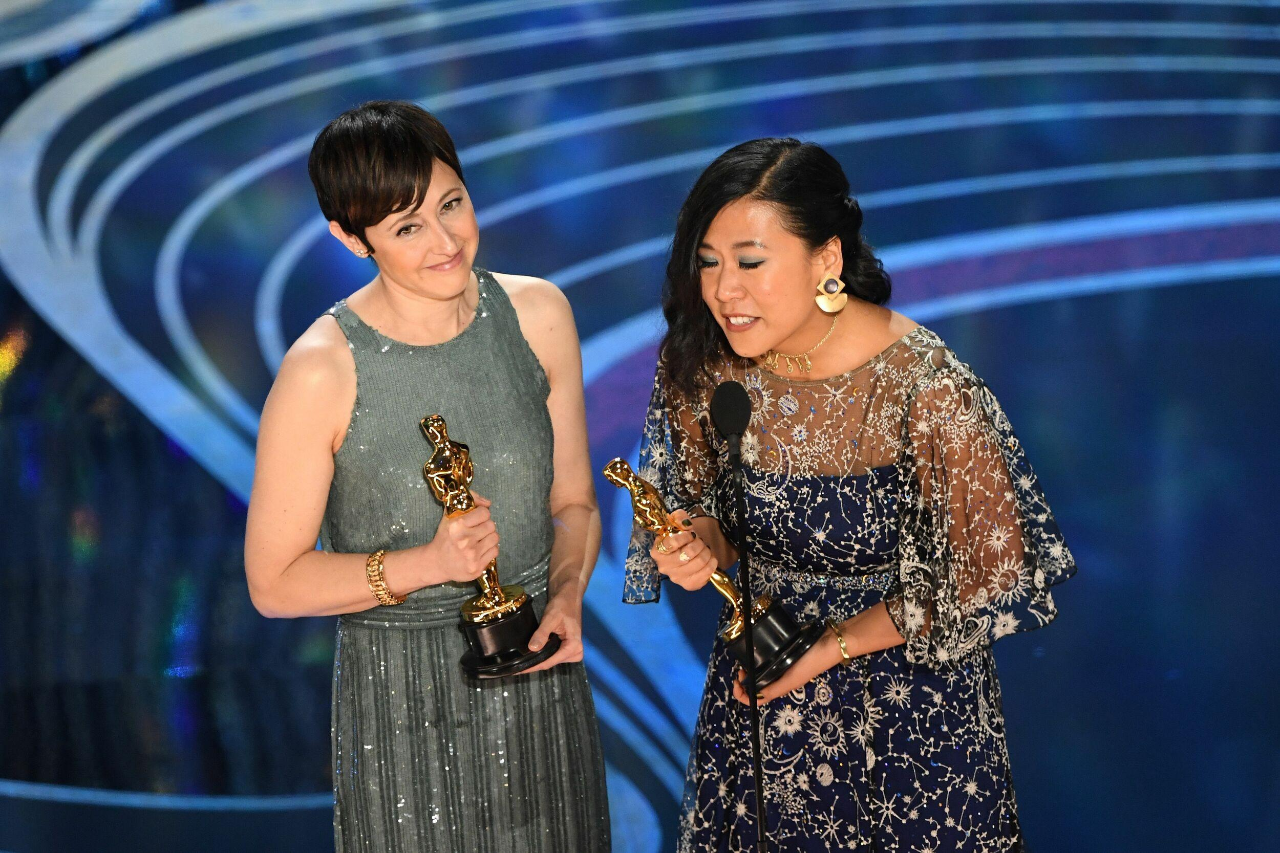 Best Animated Short Film nominees for 'Bao' Domee Shi (R) and Becky Neiman-Cobb accepts the award for Best Animated Short Film during the 91st Annual Academy Awards at the Dolby Theatre in Hollywood, California on February 24, 2019. (Photo by VALERIE MACON / AFP)        (Photo credit should read VALERIE MACON/AFP/Getty Images)