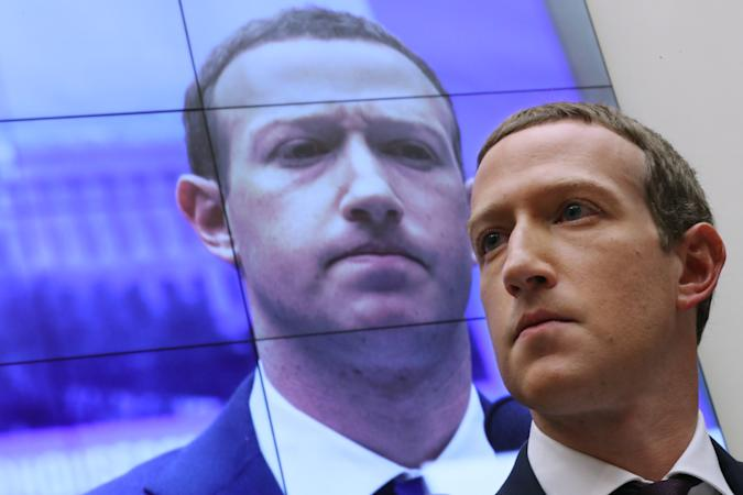 WASHINGTON, DC - OCTOBER 23: With an image of himself on a screen in the background, Facebook co-founder and CEO Mark Zuckerberg testifies before the House Financial Services Committee in the Rayburn House Office Building on Capitol Hill October 23, 2019 in Washington, DC. Zuckerberg testified about Facebook's proposed cryptocurrency Libra, how his company will handle false and misleading information by political leaders during the 2020 campaign and how it handles its users' data and privacy. (Photo by Chip Somodevilla/Getty Images)