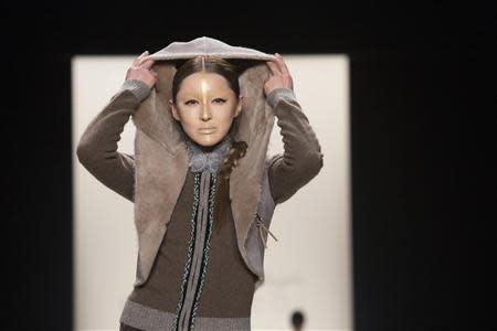 A model presents a creation from the Katya Zol 2014 Fall/Winter collection during New York Fashion Week