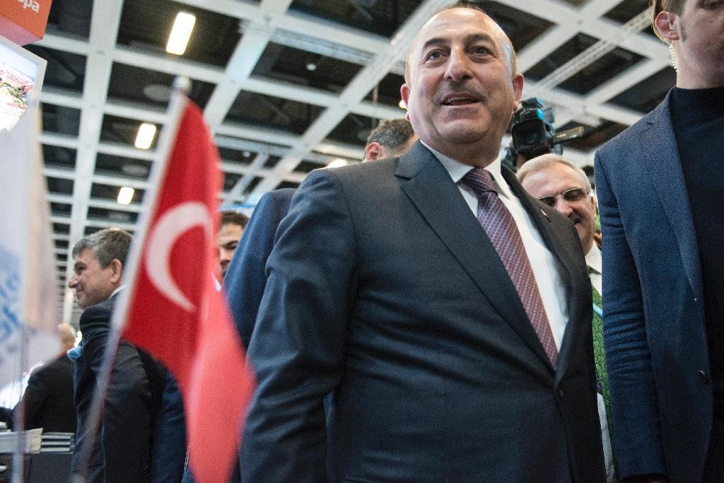 "Cavusoglu, speaking in Istanbul, said the ban was ""unacceptable"" (AFP Photo/STEFFI LOOS)"