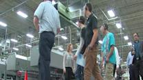 Students tour manufacturing plant.