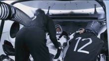 Astronauts strap into SpaceX capsule before launch day