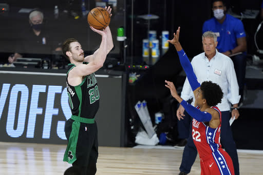 Boston Celtics' Gordon Hayward (20) shoots as Philadelphia 76ers' Matisse Thybulle (22) defends during the first half of an NBA basketball first round playoff game Monday, Aug. 17, 2020, in Lake Buena Vista, Fla. (AP Photo/Ashley Landis, Pool)