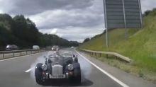 Classic car slams into stationary traffic