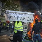 Yellow vests: Protesters in Paris set fire to dozens of cars in anger at millionaire Notre Dame donations
