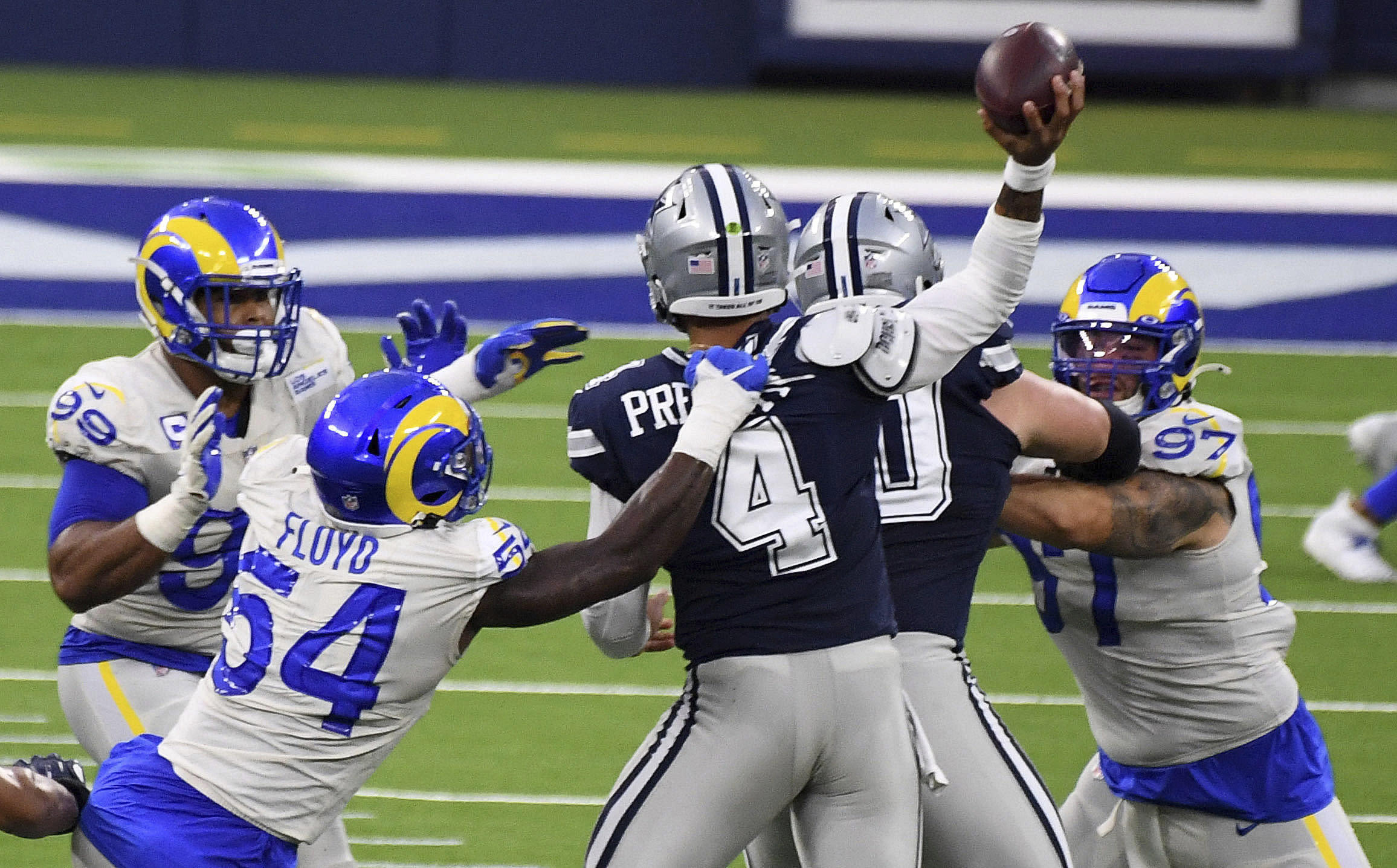 Outside linebacker Leonard Floyd (54) of the Los Angeles Rams pressures quarterback Dak Prescott (4) of the Dallas Cowboys in the first half of a NFL football game on opening night at SoFi Stadium in Inglewood on Sunday, September 13, 2020. (Keith Birmingham/The Orange County Register via AP)