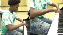 Teen born with four fingers plays piano like a dream