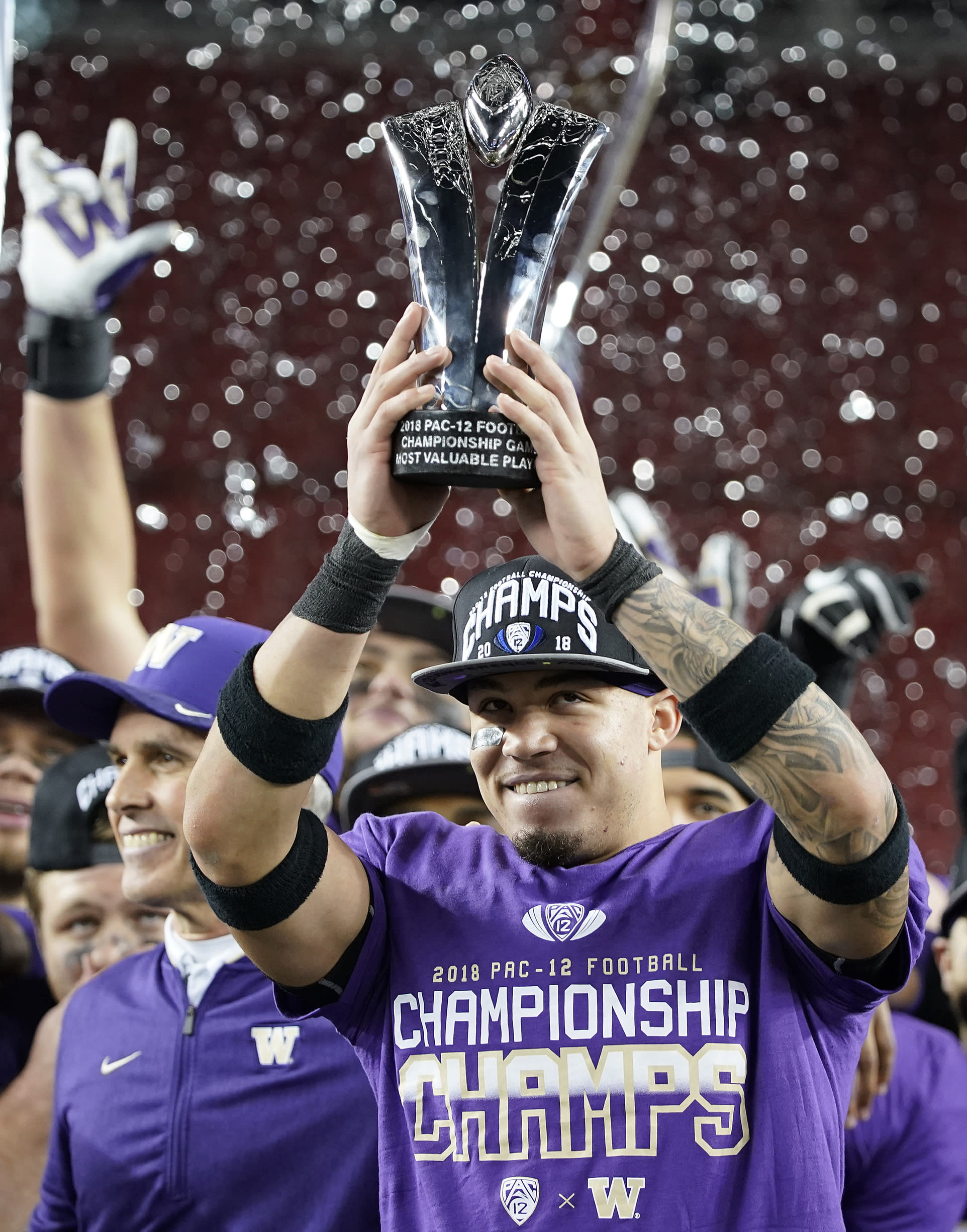 Washington defensive back Byron Murphy celebrates after Washington defeated Utah 10-3 in the Pac-12 Conference championship NCAA college football game in Santa Clara, Calif., Friday, Nov. 30, 2018. (AP Photo/Tony Avelar)