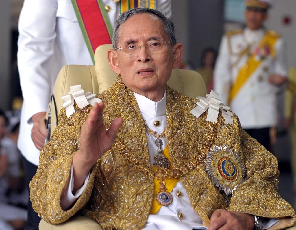 Thai King Bhumibol Adulyadej, whose reign witnessed regular bouts of political turmoil, coups and violent unrest, was revered as a serene and caring father of the nation, and a bulwark in troubled times (AFP Photo/Pornchai Kittiwongsakul)