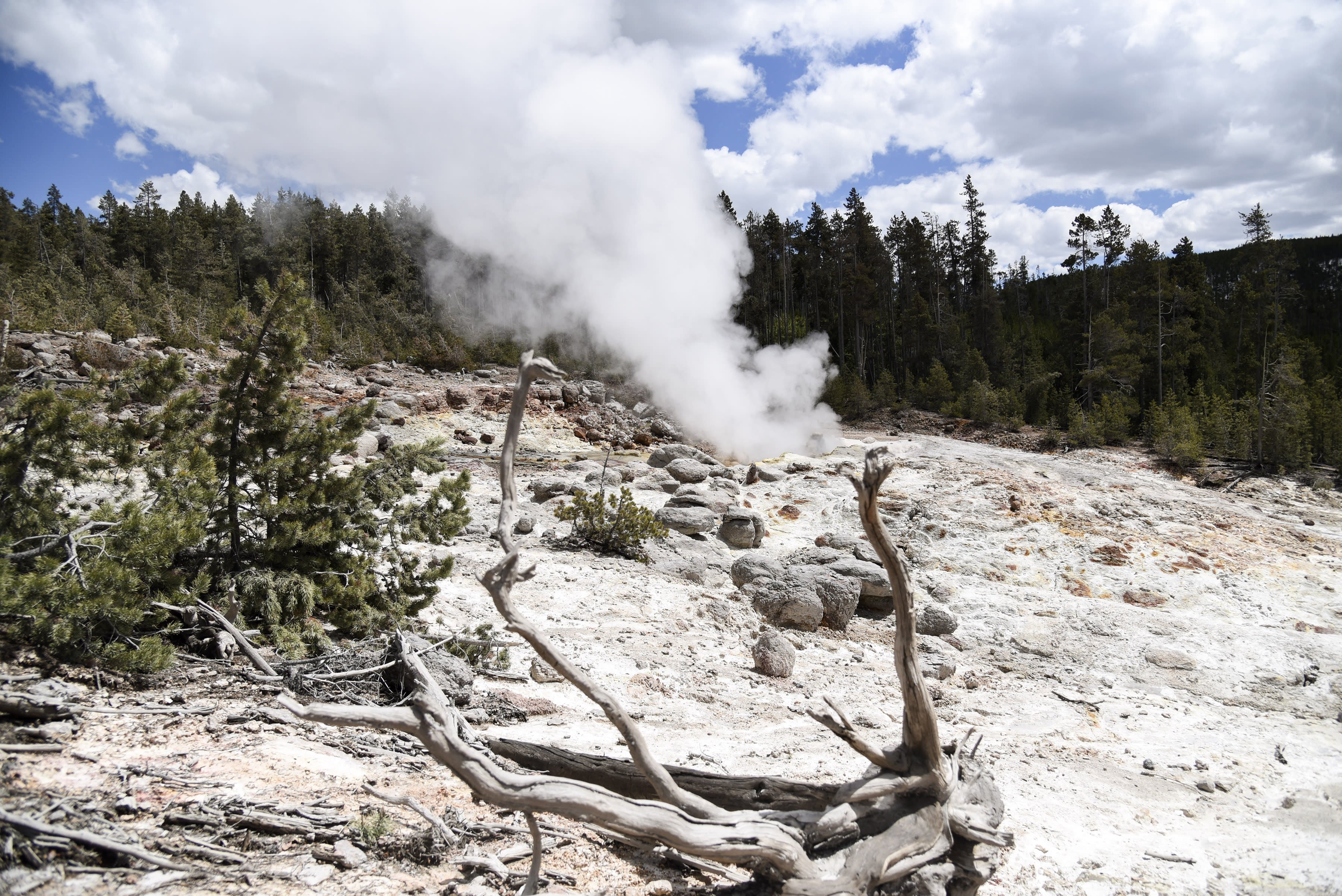 FILE - This May 15, 2018 file photo, shows Steamboat Geyser emitting a small jet of steam in Yellowstone National Park. A thermal spring near Old Faithful in Yellowstone National Park has erupted for the fourth time in the last 60 years, a park official said Thursday, Sept. 20. (Rachel Leathe /Bozeman Daily Chronicle via AP, File)