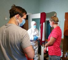 With mask and hashtags, Ukraine minister fights coronavirus rumors from quarantine