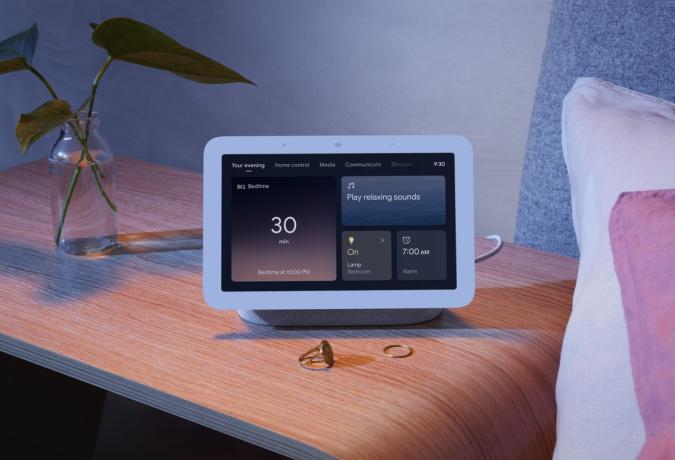 Google Nest Hub 2nd gen. A picture of the company's new smart display sitting on a bedside table in a dimmed room.