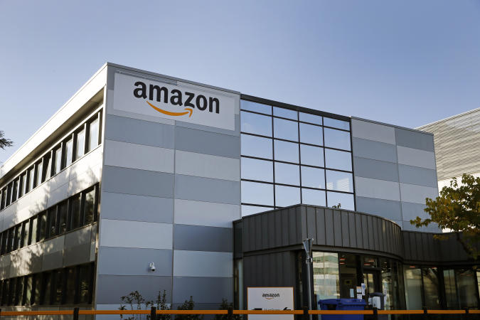"VELIZY-VILLACOUBLAY, FRANCE - NOVEMBER 20: The logo of Amazon is seen on the facade of its  warehouse on November 20, 2020 in Velizy-Villacoublay near Paris, France. General Manager of Amazon France, Frédéric Duval, announced the postponement of Black Friday from November 27 to December 4. ""Today, like other large French distributors and taking into account the recommendation of the French Government, we have decided to postpone Black Friday if this allows businesses to reopen before December 1 and therefore this year, Black Friday will take place on December 4. "" Amazon France confirmed in a statement. (Photo by Chesnot/Getty Images)"