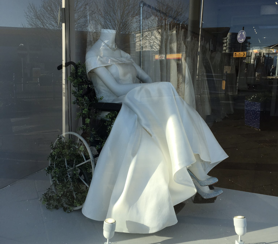 Bridal shop praised for displaying gown on mannequin in wheelchair