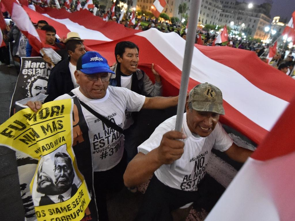 Thousands of activists gather to rally and march in Lima on May 31, 2016, opposing the candidacy of Keiko Fujimori in the runoff election (AFP Photo/Cris Bouroncle)