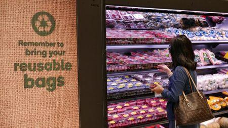 A shopper selects items inside a plastic bag-free Woolworths supermarket in Sydney, Australia, June 15, 2018. REUTERS/Jill Gralow