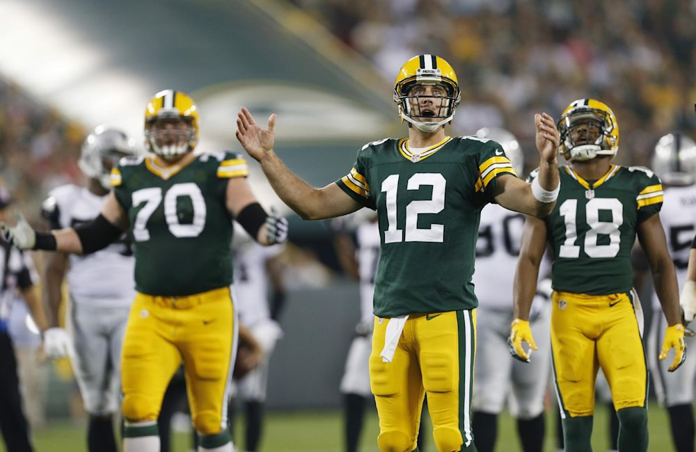 Green Bay Packers quarterback Aaron Rodgers reacts to a call during the first half of an NFL preseason football game against the Oakland Raiders Friday, Aug. 22, 2014, in Green Bay, Wis
