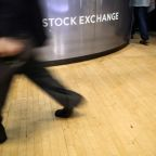 Wall Street falls as Fed signals smaller rate cut