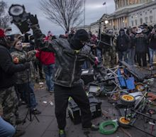 Capitol rioters communicated using military hand signals, source says
