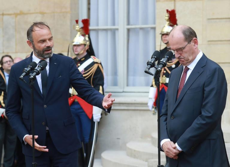 As Edouard Philippe (left) handed the prime ministerial mantle to Jean Castex (right) in Paris some analysts saw President Macron as tightening his own power grip (AFP Photo/Ludovic Marin)