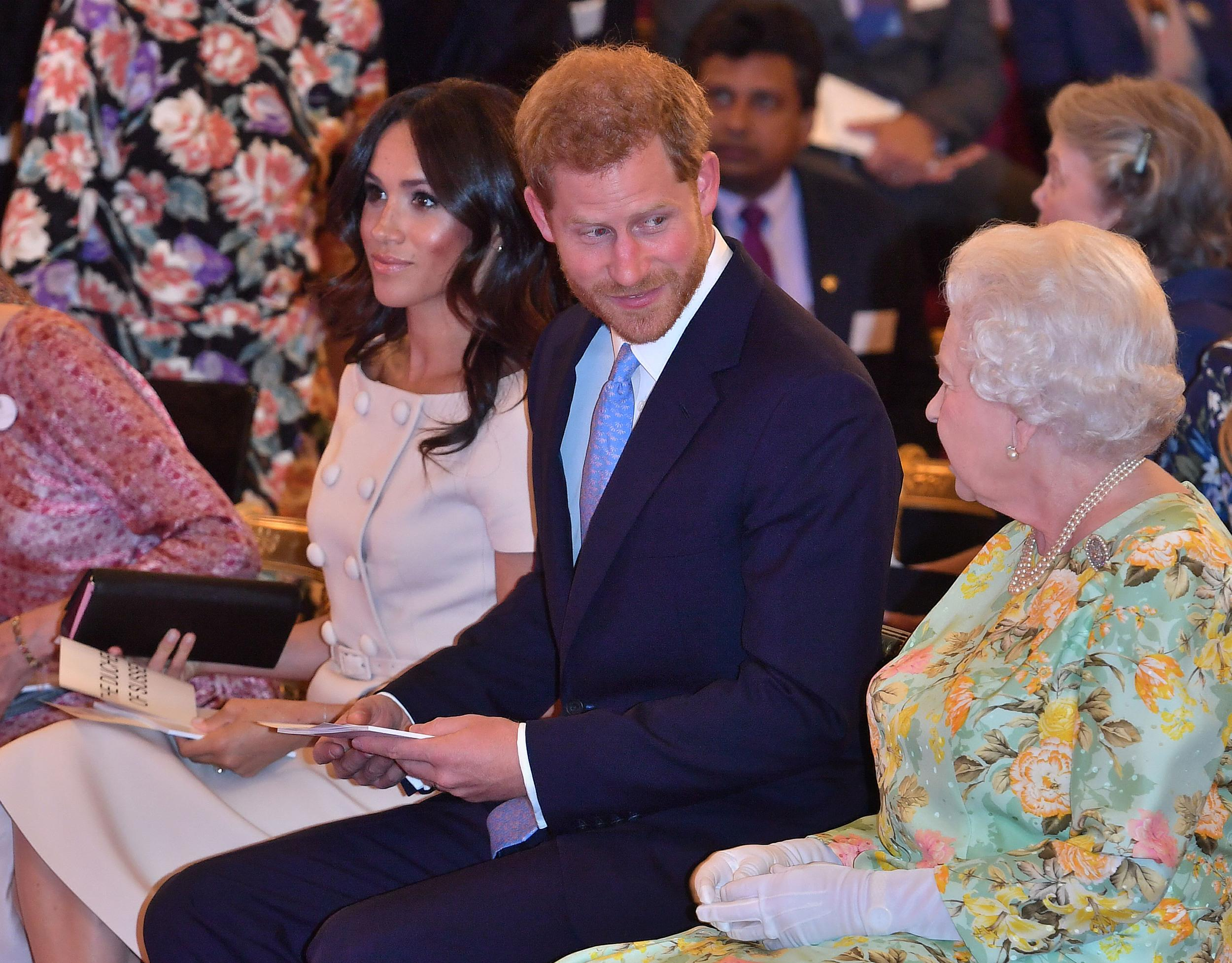 Britain's Queen Elizabeth II (R) talks with Britain's Prince Charles, Prince of Wales and Meghan, Duchess of Sussex before the Queen's Young Leaders Awards Ceremony on June 26, 2018 at Buckingham Palace in London. (Photo by John Stillwell / POOL / AFP)        (Photo credit should read JOHN STILLWELL/AFP/Getty Images)