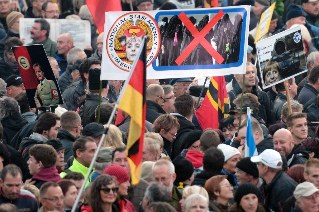 Supporters of the PEGIDA movement gather at a protest rally on October 19, 2015 in Dresden, eastern Germany (AFP Photo/Robert Michael)