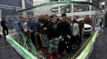 Czech bubble artist surrounds 275 students with soap 'screen' to claim record