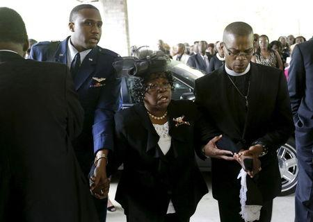 Judy Scott, center, is escorted in for the funeral of her son, Walter Scott, at W.O.R.D. Ministries Christian Center, Saturday, April 11, 2015, in Summerville. Scott was killed by a North Charleston police officer on April 4, 2015. The officer, Michael Thomas Slager, has been charged with murder. REUTERS/David Goldman/Pool