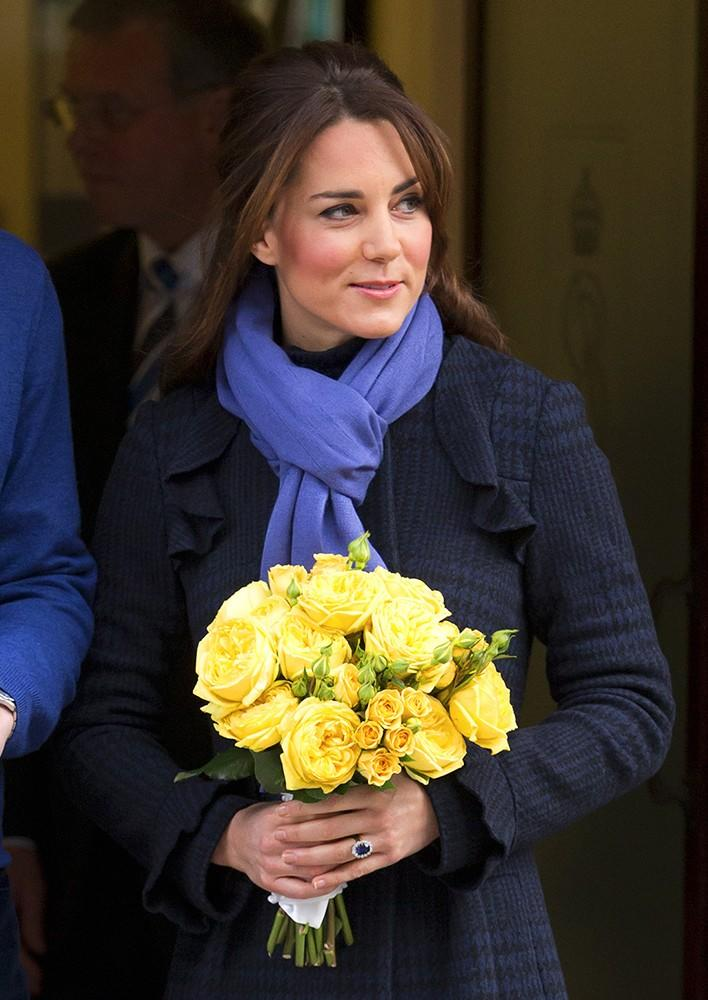 Kate left the hospital, after being admitted for severe morning sickness, in a navy coat by Diane von Furstenberg.