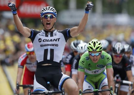 Giant-Shimano team rider Kittel of Germany celebrates as he crosses the finish line to win the 155 km third stage of the Tour de France cycling race from Cambridge to London