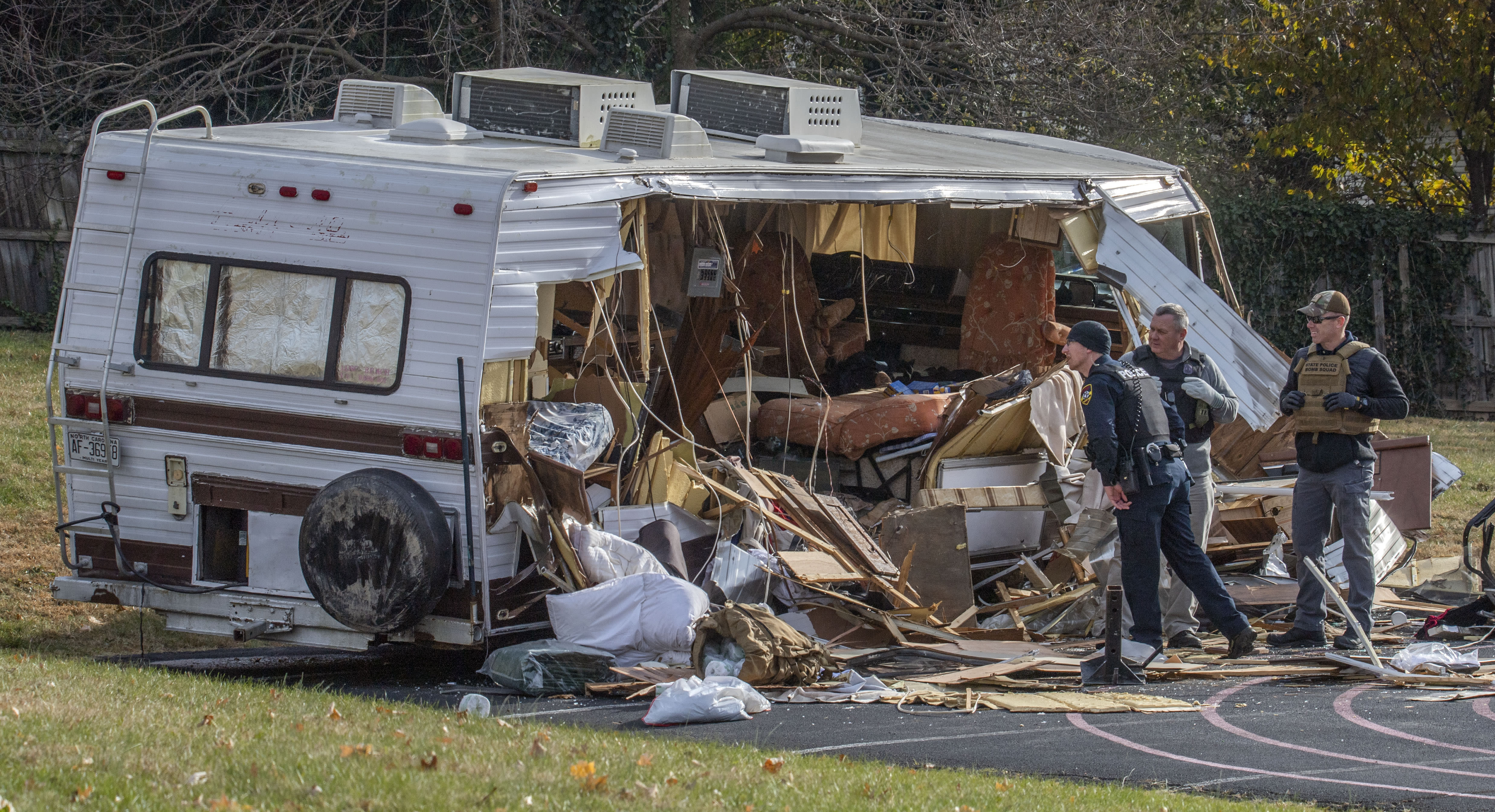 Police examine a stolen RV after ramming it multiple times with an armored vehicle while searching for a Marine deserter who is wanted for questioning in a murder case, in Roanoke, Va. (AP Photo/Don Petersen)