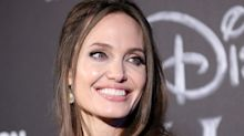 Angelina Jolie, Disney's best dressed villain, is bewitching in corset dress at Maleficent premiere